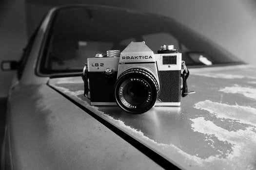 Gray Scale Photography of Silver and Black Praktica Dslr Camera