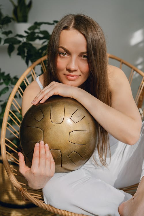 A Woman Holding a Copper Metalcraft