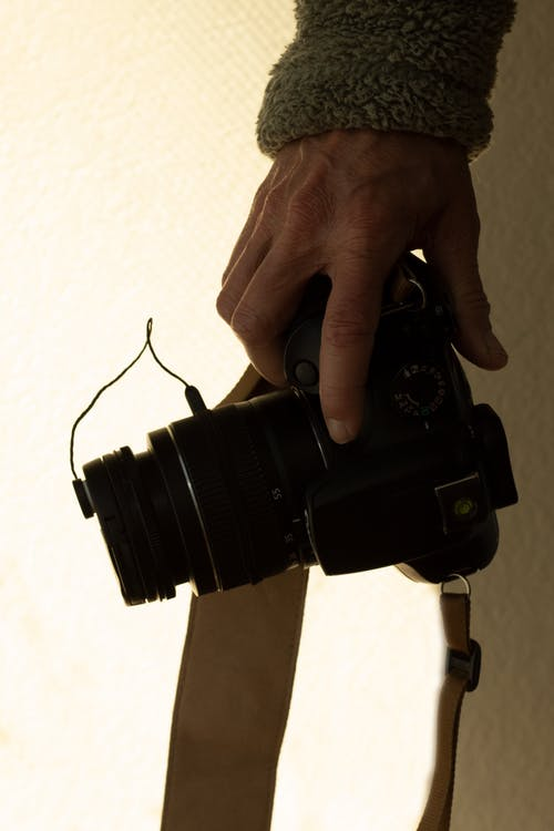 Free stock photo of camera, hand, holding