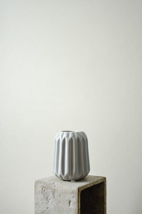 Ceramic Vase on the Concrete Box