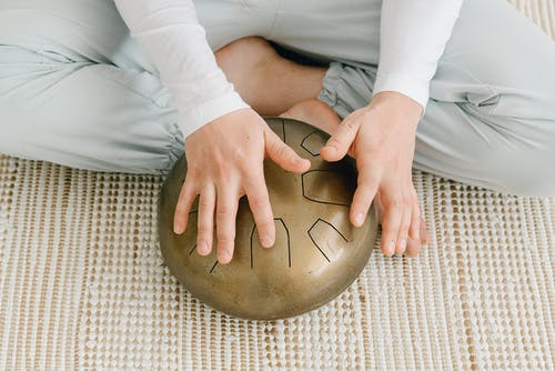 Woman sitting on floor with hapi drum