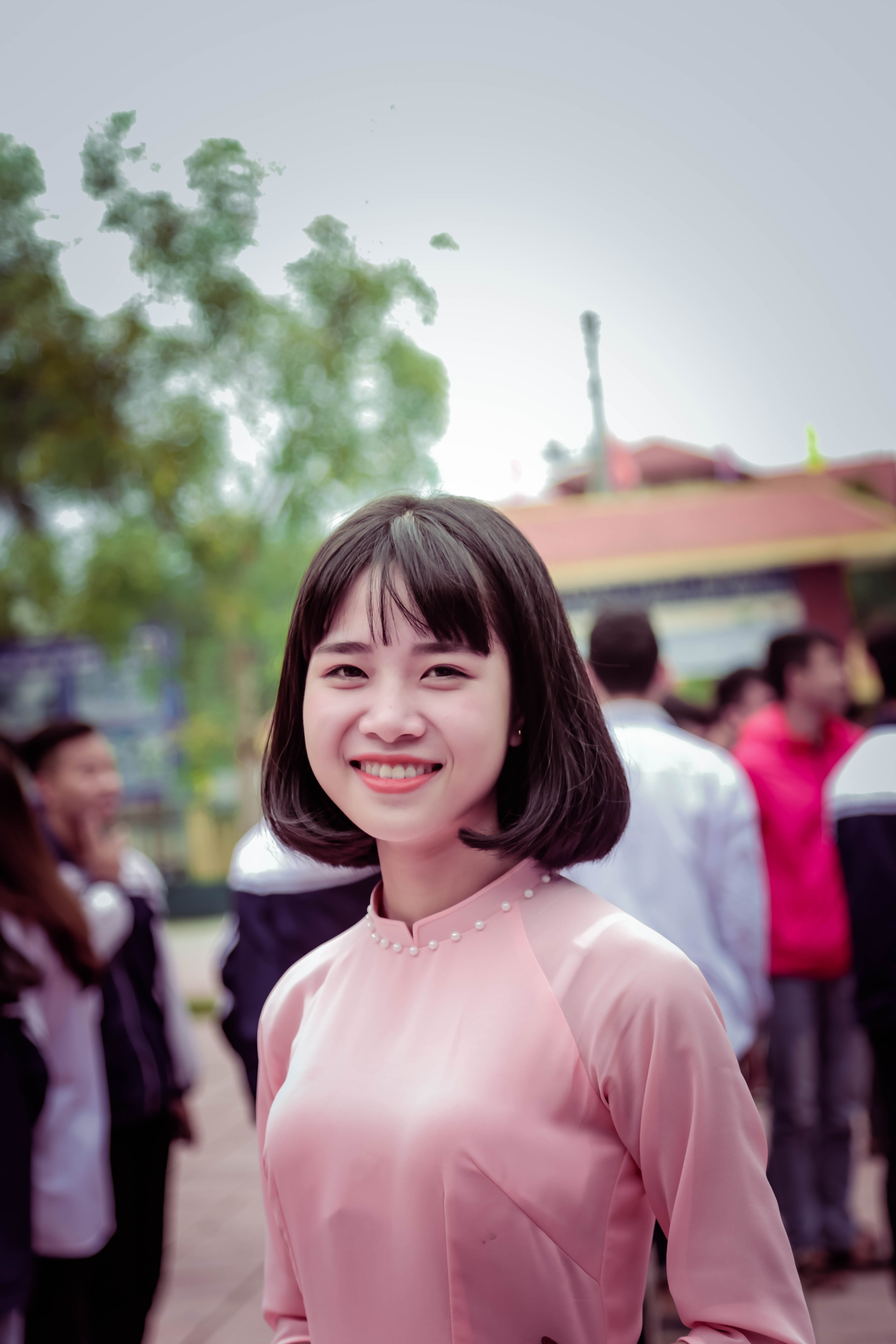 Photography of a Woman in Pink Long-sleeved Top Smiling
