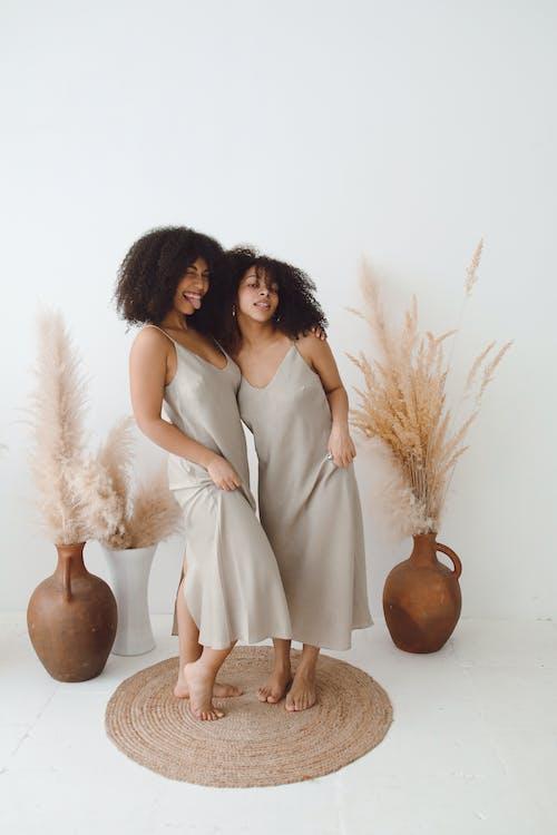 Women Wearing the Same Design Spaghetti Dress
