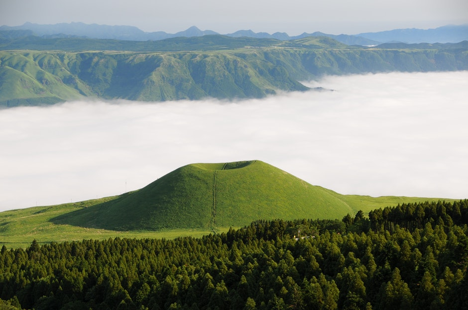 Green Mountain in Front of White Clouds