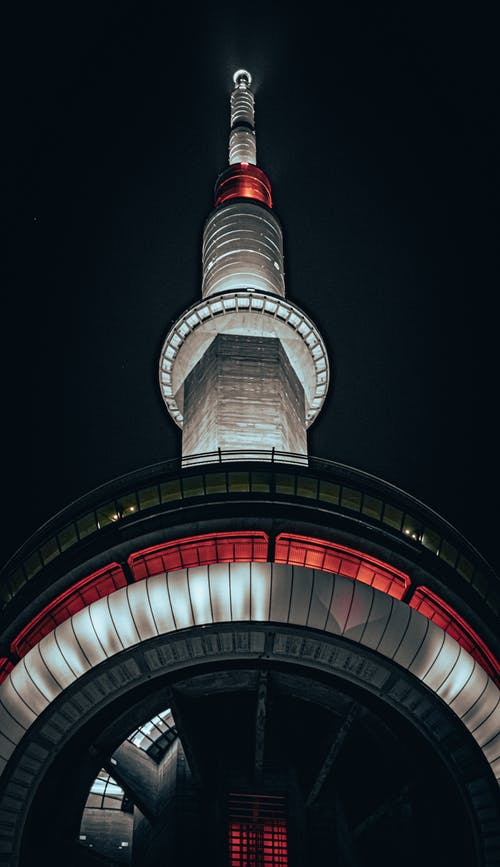 Low Angle Photography of Red and White Tower