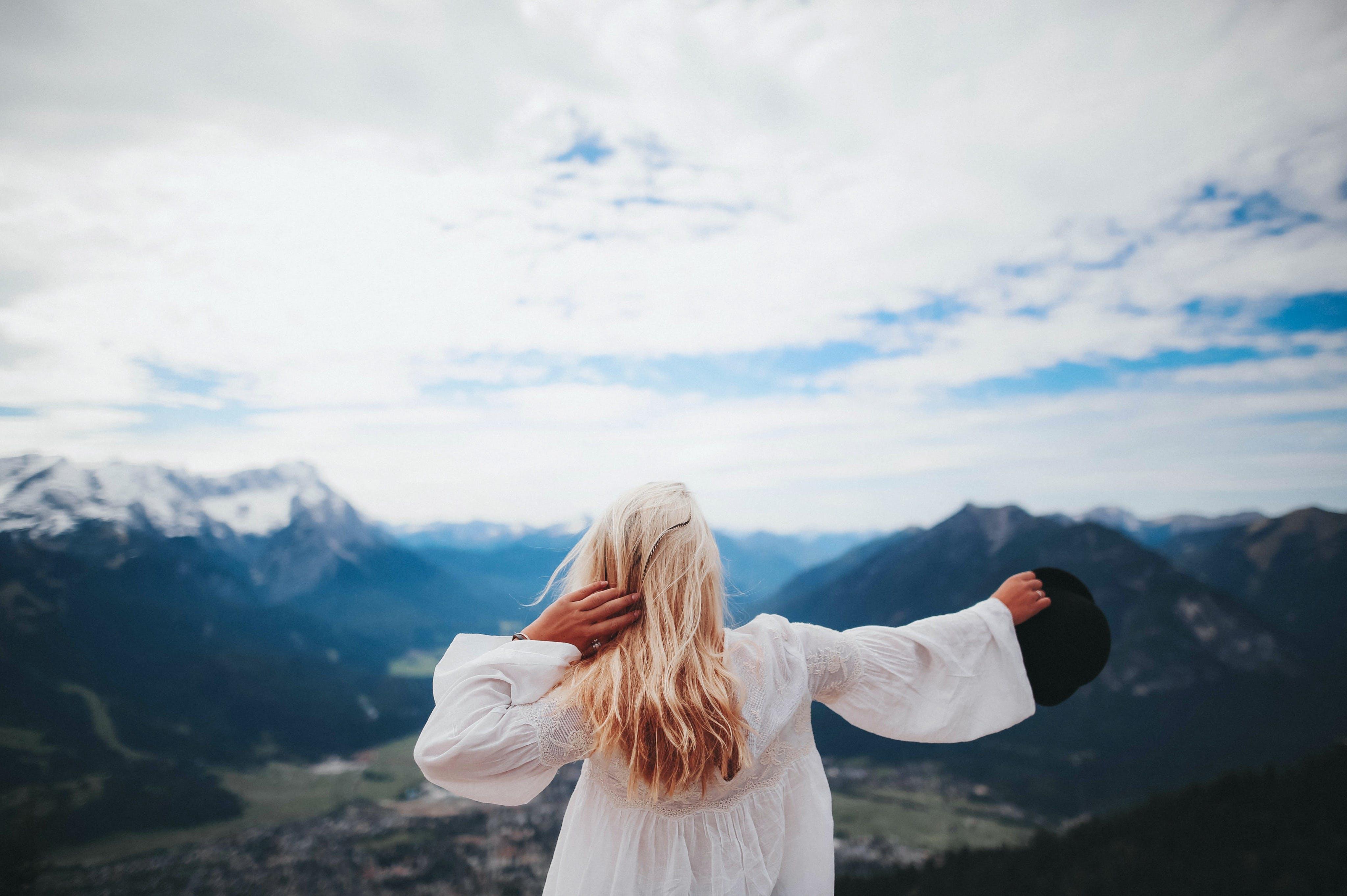 White Dressed Girl Across Black Mountains
