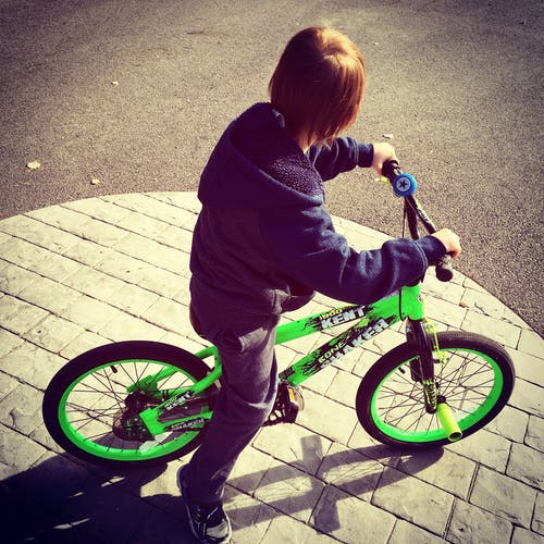 Boy Riding Bike at Daytime