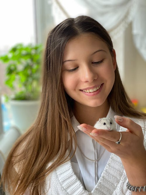 Close-Up Shot of a Woman Playing with a Cute Mouse