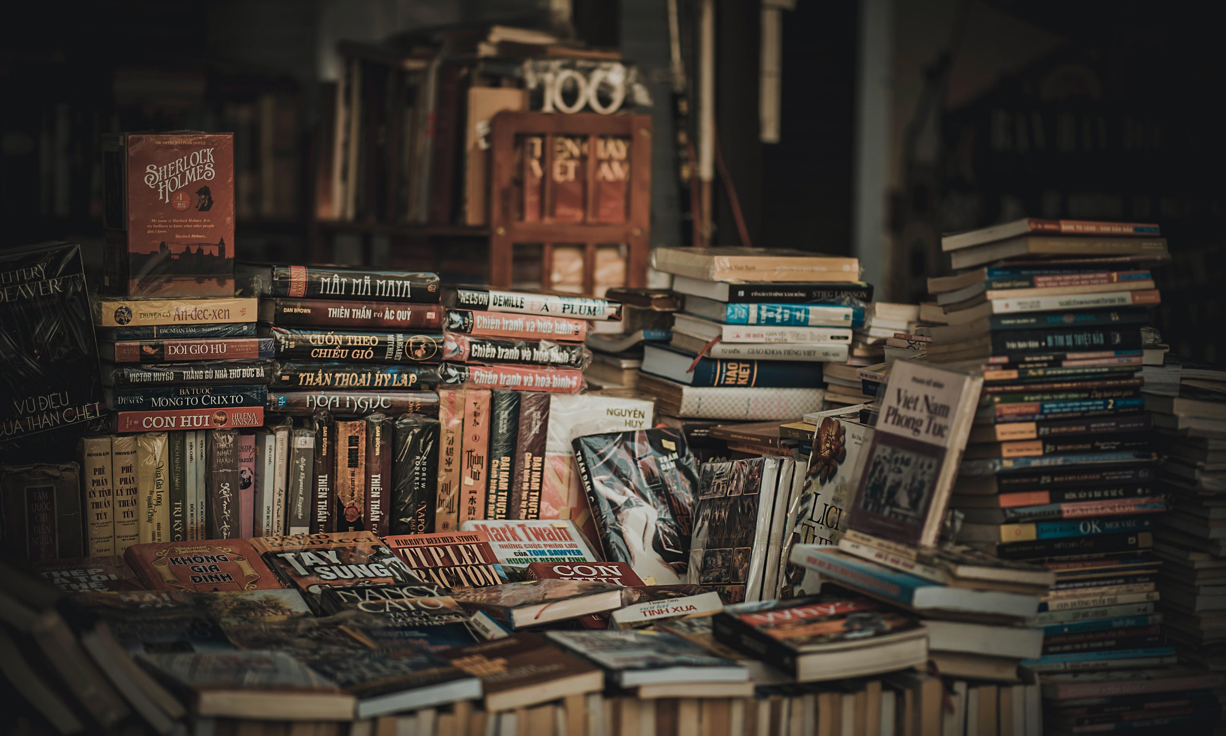 pile of assorted novel books free stock photo