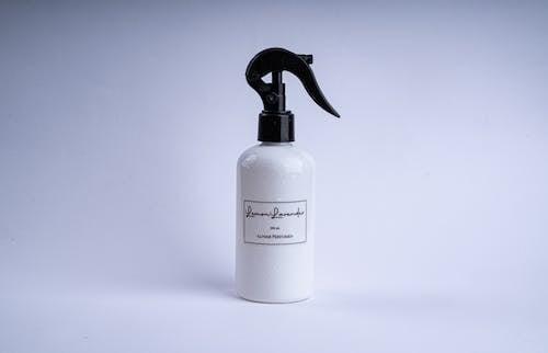 Perfume In White Spray Bottle