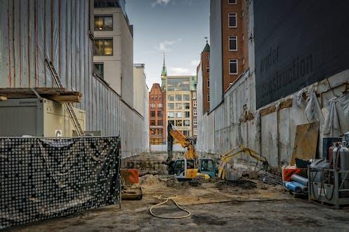 Základová fotografie zdarma na téma architektura, bagr, budovy, dlažba