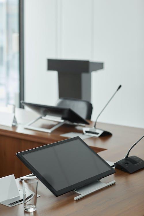 Black Digital Tablet On Wooden Table
