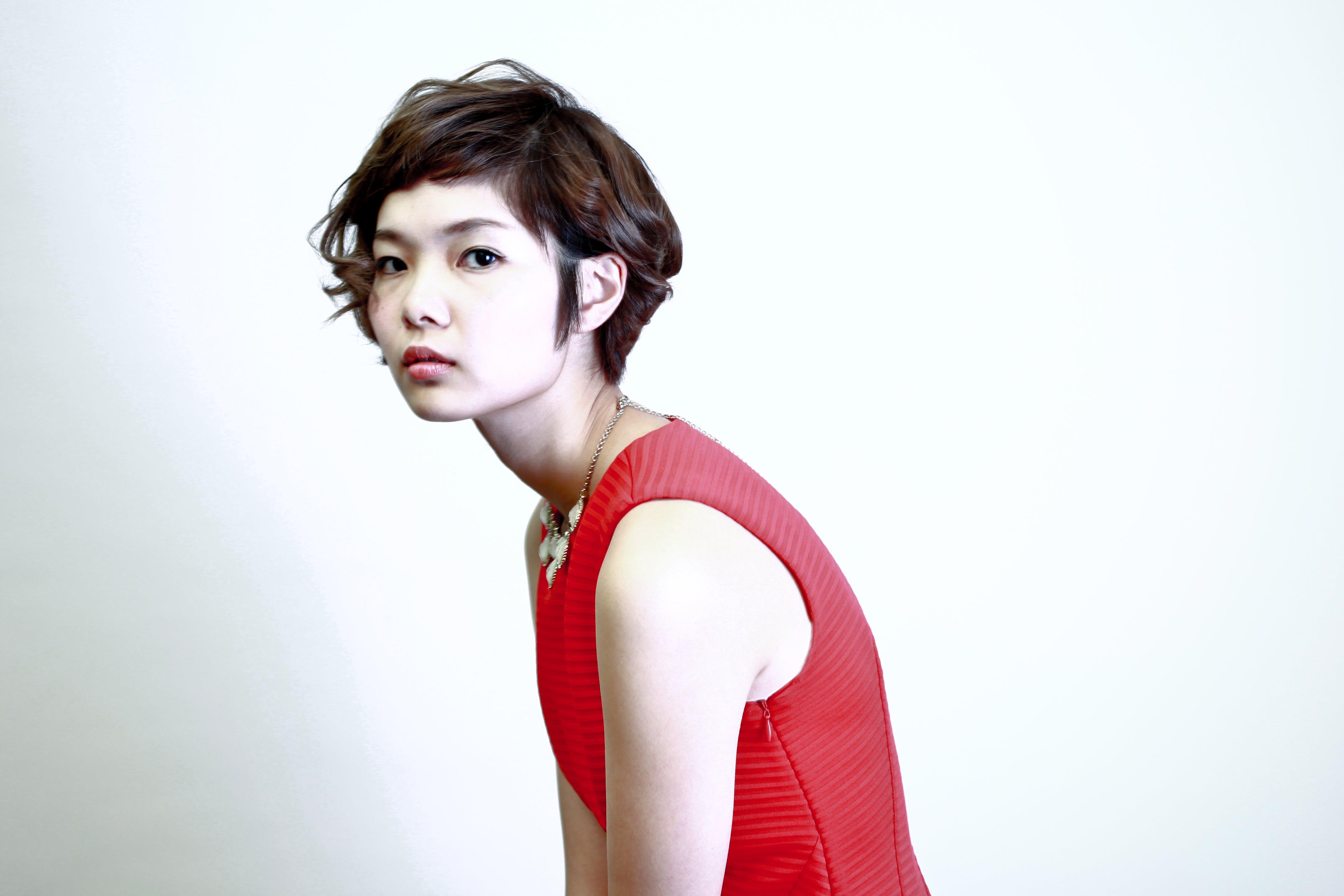 Woman Wearing Red Sleeveless Top