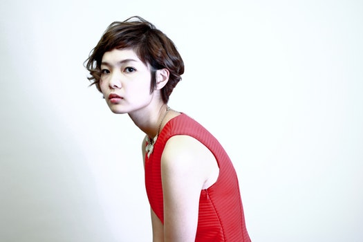 Woman Wearing Red Sleeveless Top