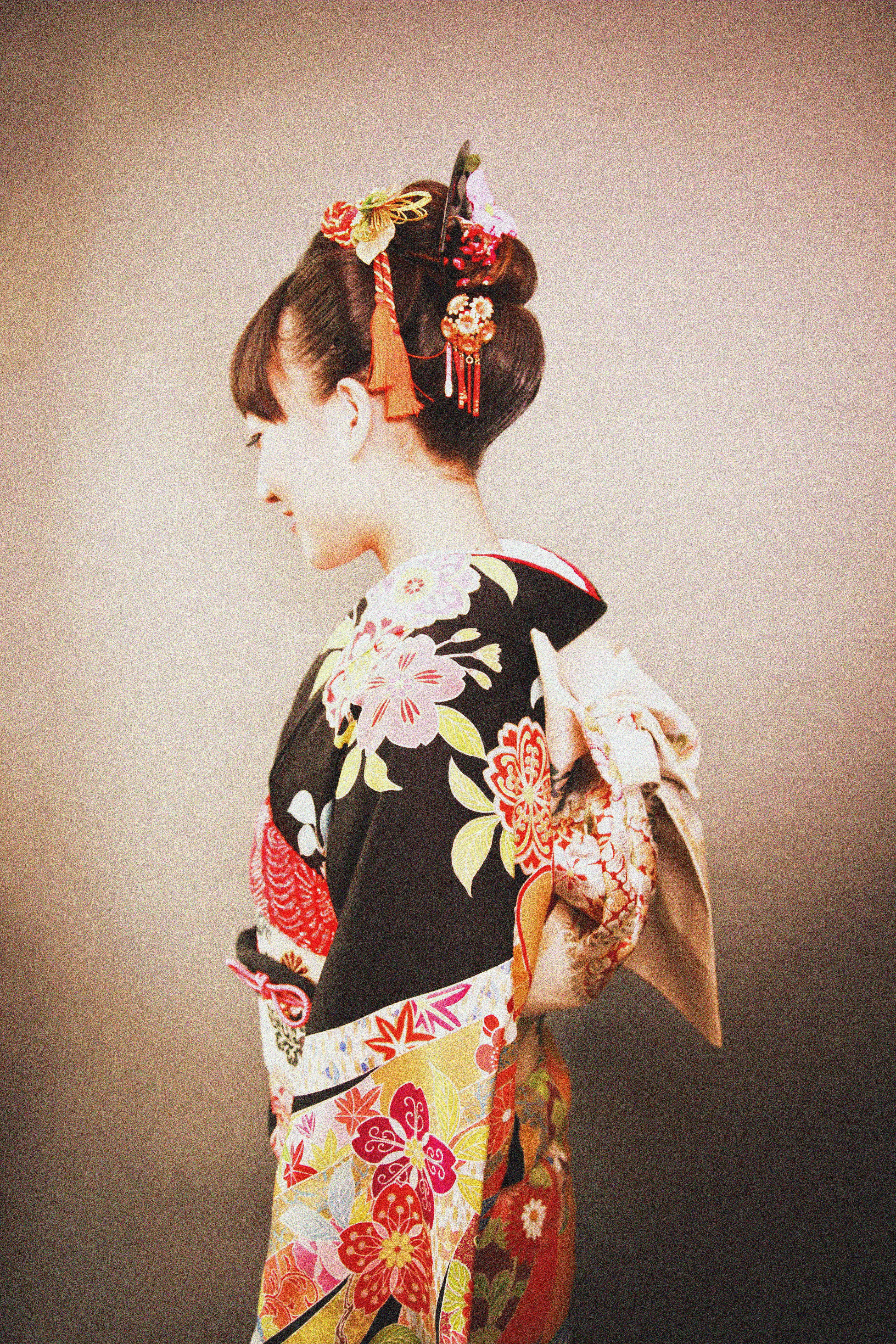 Woman in Black Yellow and Red Floral Kimuno Dress