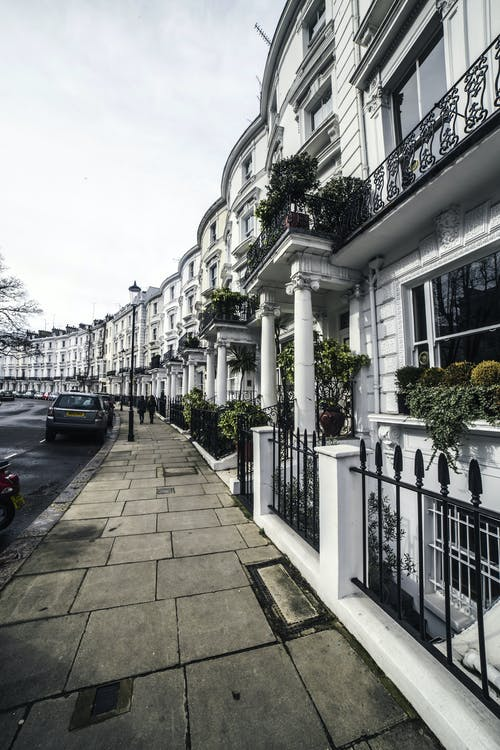 Facades of residential buildings along sidewalk