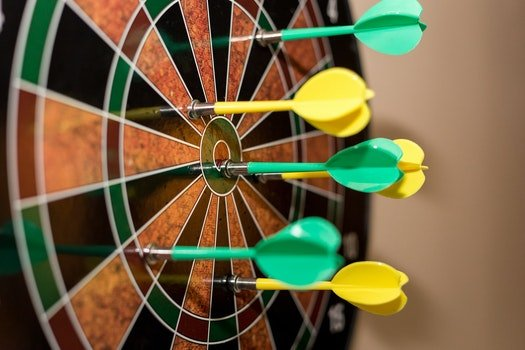 Green and Yellow Darts on Brown-black-green-and-red Dartboard