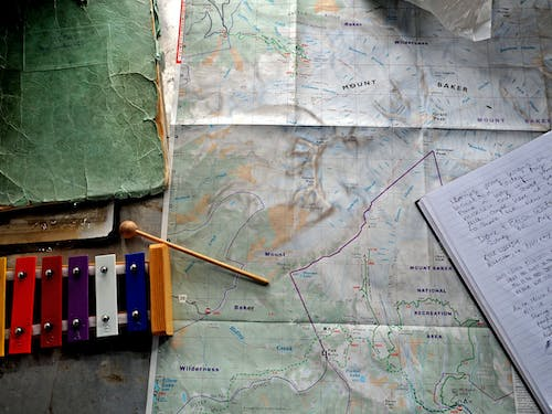 Free stock photo of desk, hike, journal, map