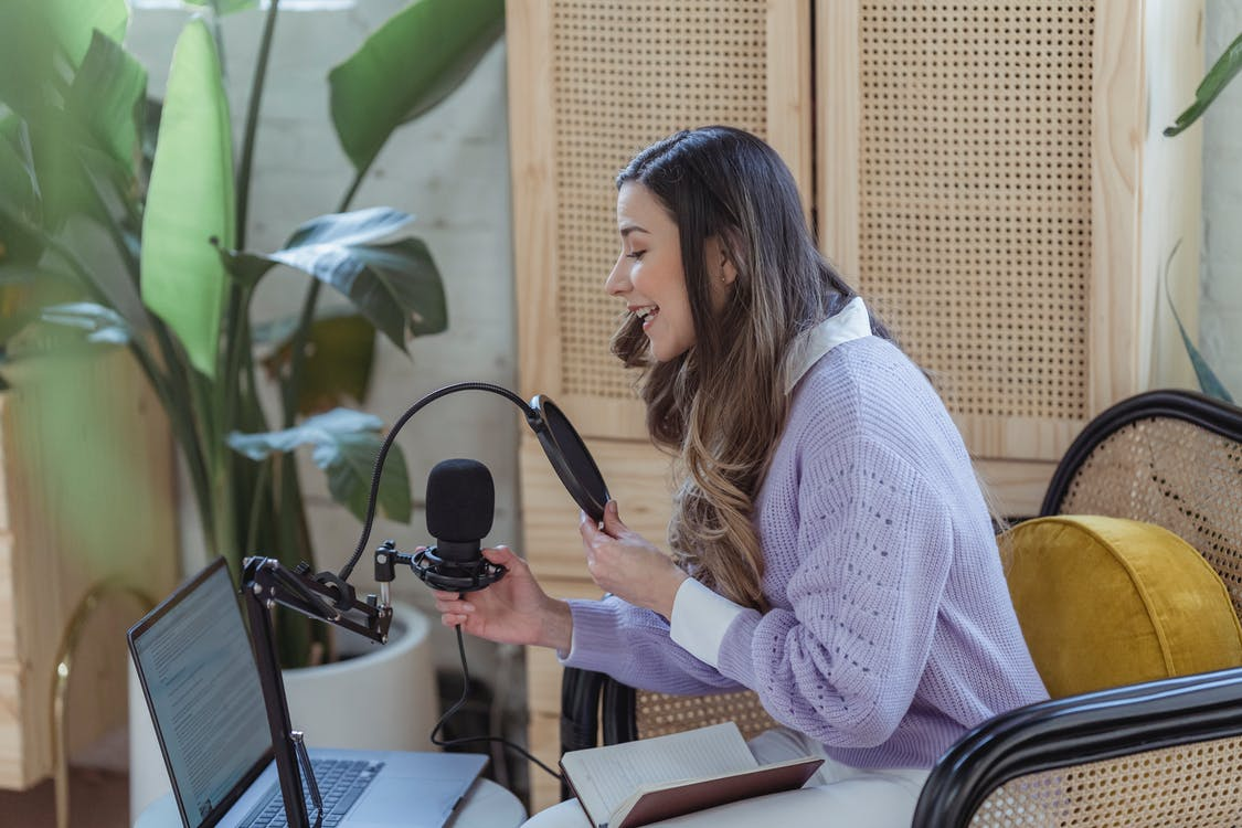 Woman recording audio podcast on equipment