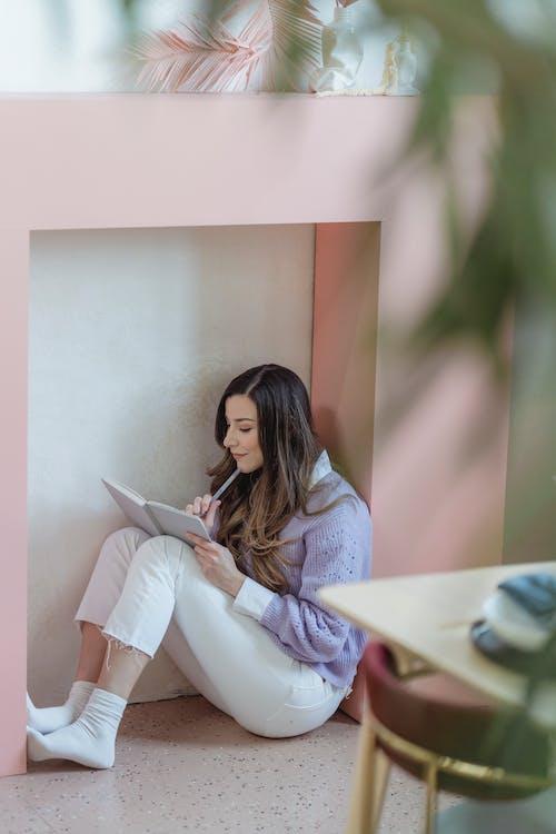 Focused woman writing in notebook