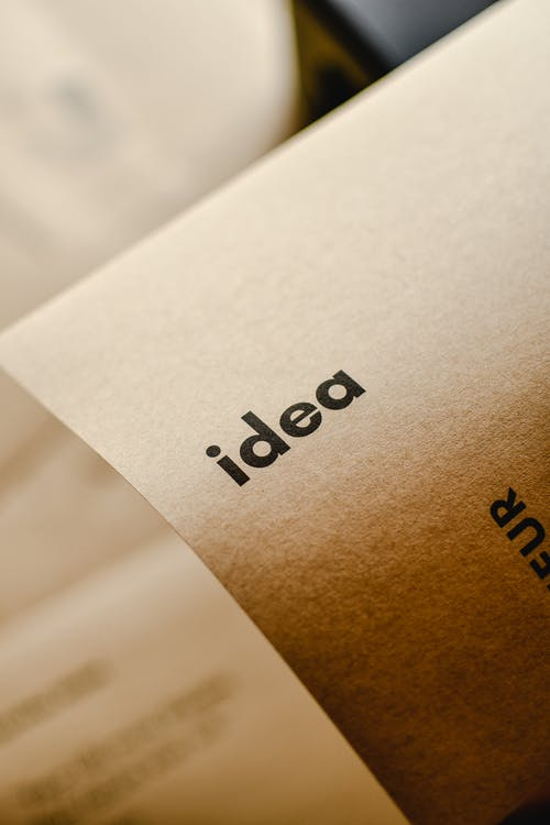 Close-Up Shot of an Idea Text on a Brown Paper
