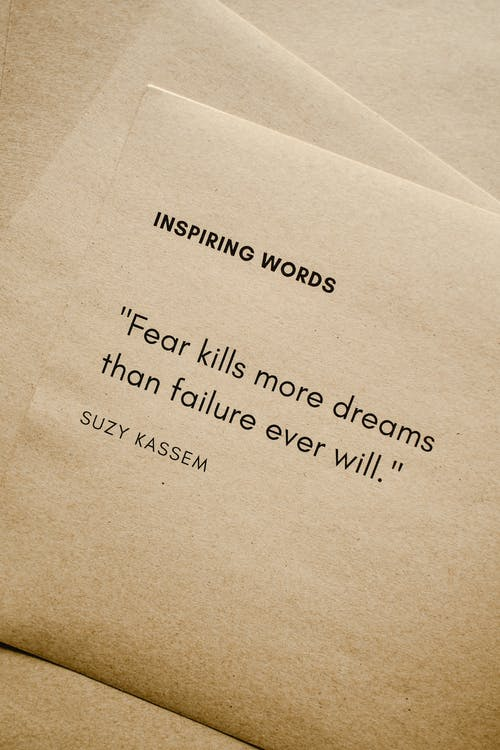 Close-Up Shot of Inspiring Words on a Brown Paper