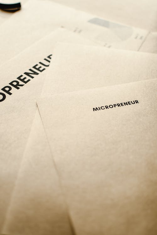 Close-Up Shot of a Micropreneur Text on a Brown Paper
