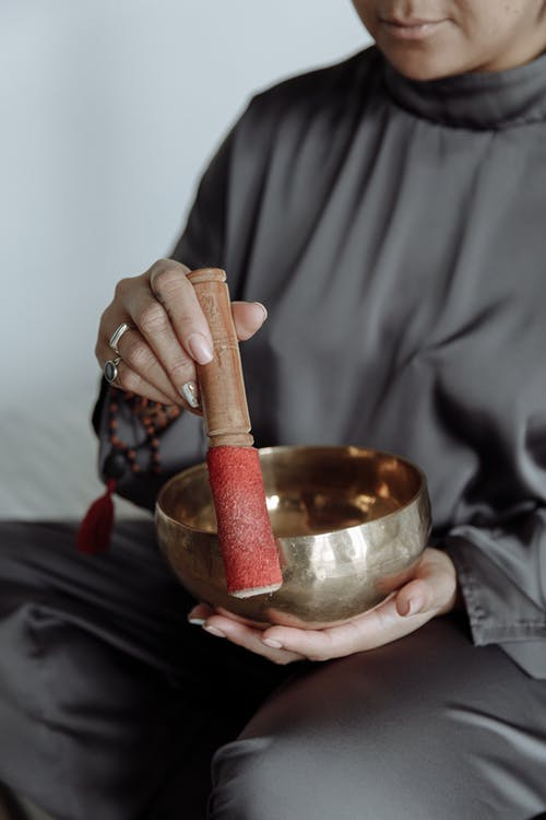 Person Holding Stainless Steel Bowl