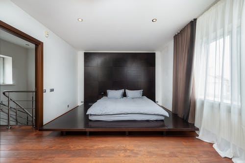 Bedroom interior with bed against window in house