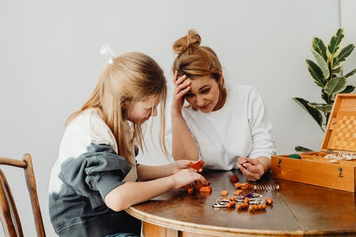 Women Playing Puzzle Games