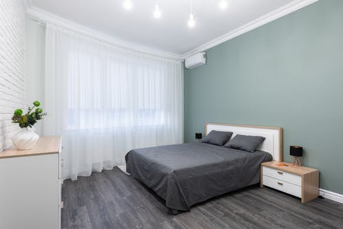 Modern bedroom interior with furniture under shiny lamps