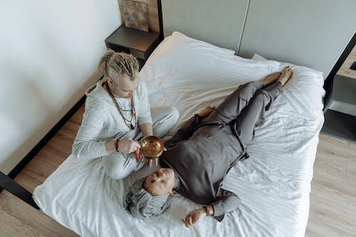 High Angle Shot of Woman Lying Down on Bed