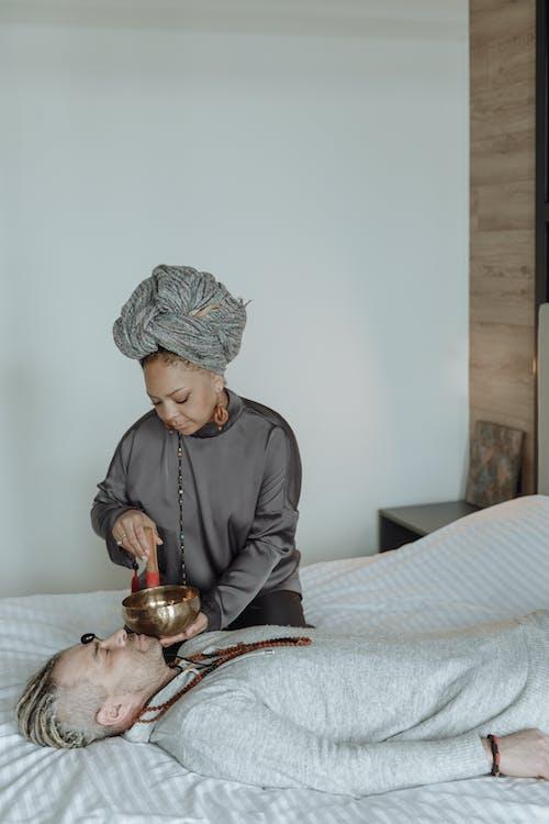Woman Using Spiritual Healing Bowl