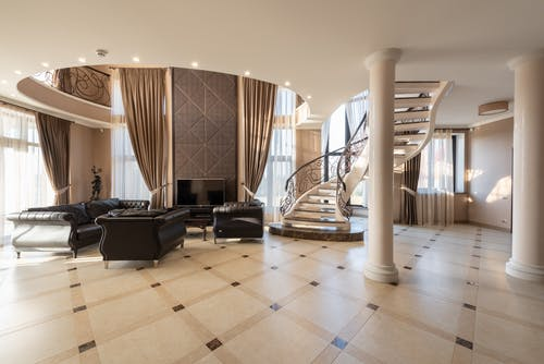 Spacious elegant house with pillars and comfy sofa and armchairs