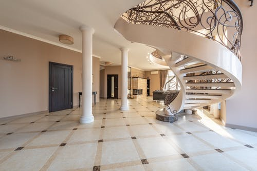 Spacious hall of modern house with staircase