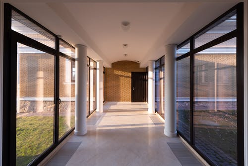Corridor of modern building with glass walls