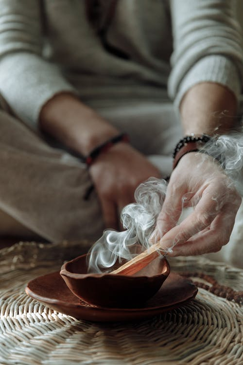 Close Up Photo of Person Smudging