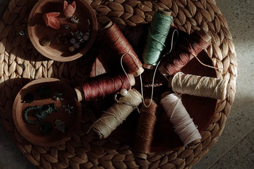Threads on Brown Wooden Spool