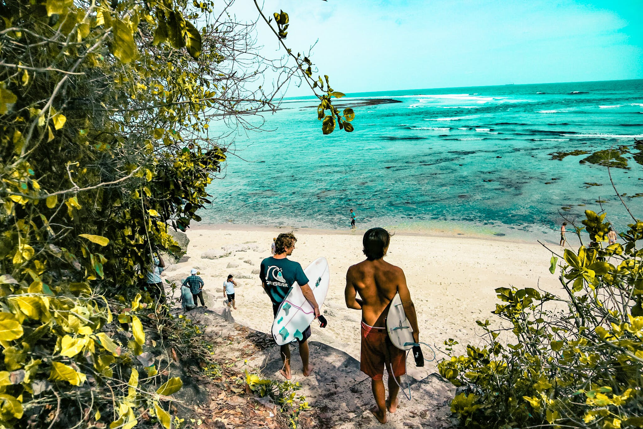 Two Man Holding Surfboards Going to Beach
