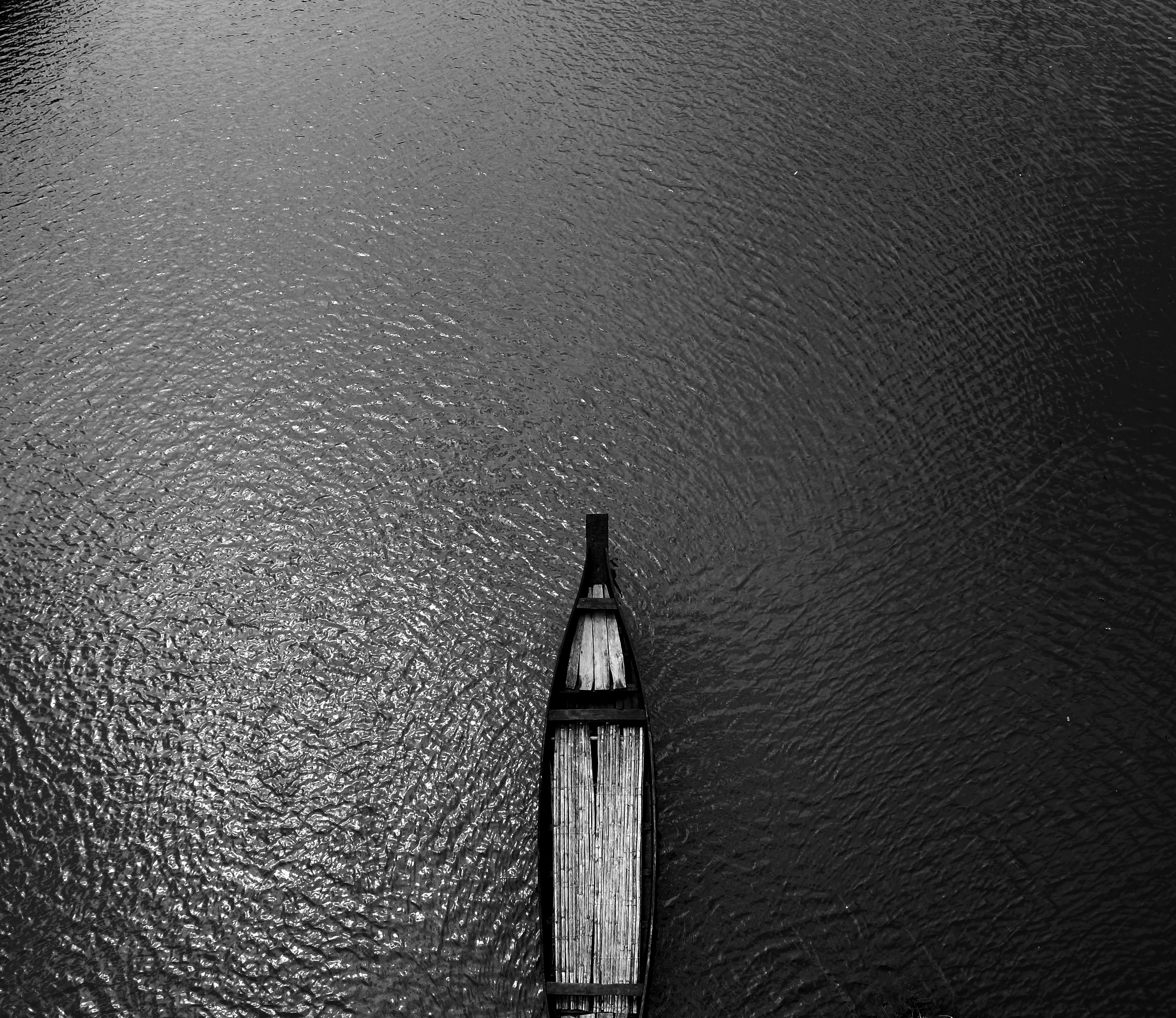 Aerial View Black Wooden Row Boat on Body of Water