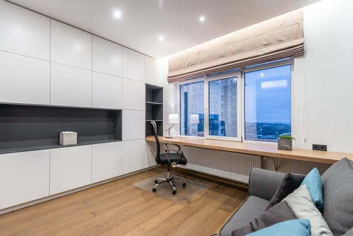 Modern room with couch and cupboard