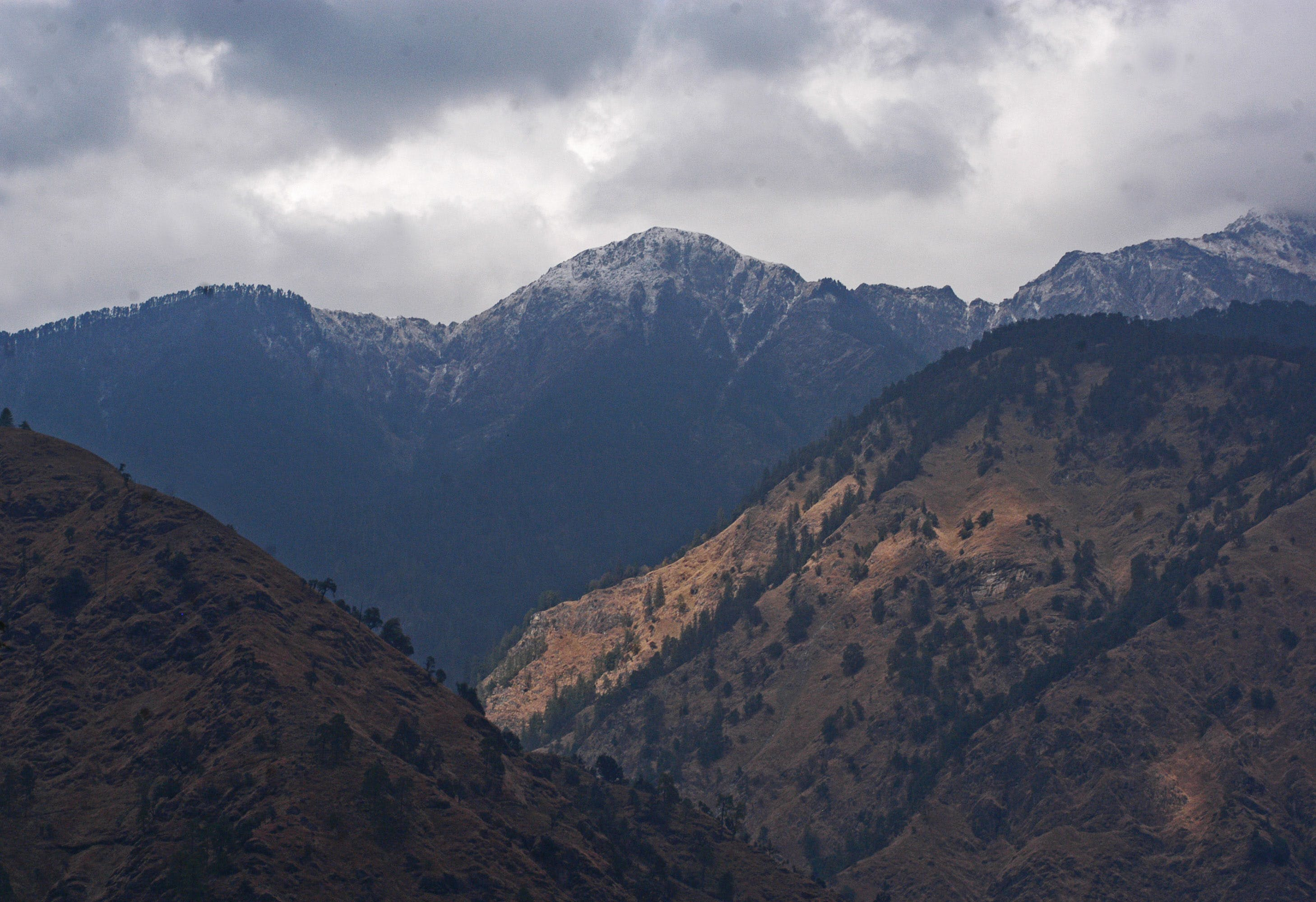 Brown Mountain Under White Cloudy Sky