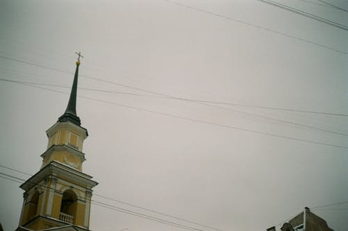 Fragment of historic church against cloudy sky