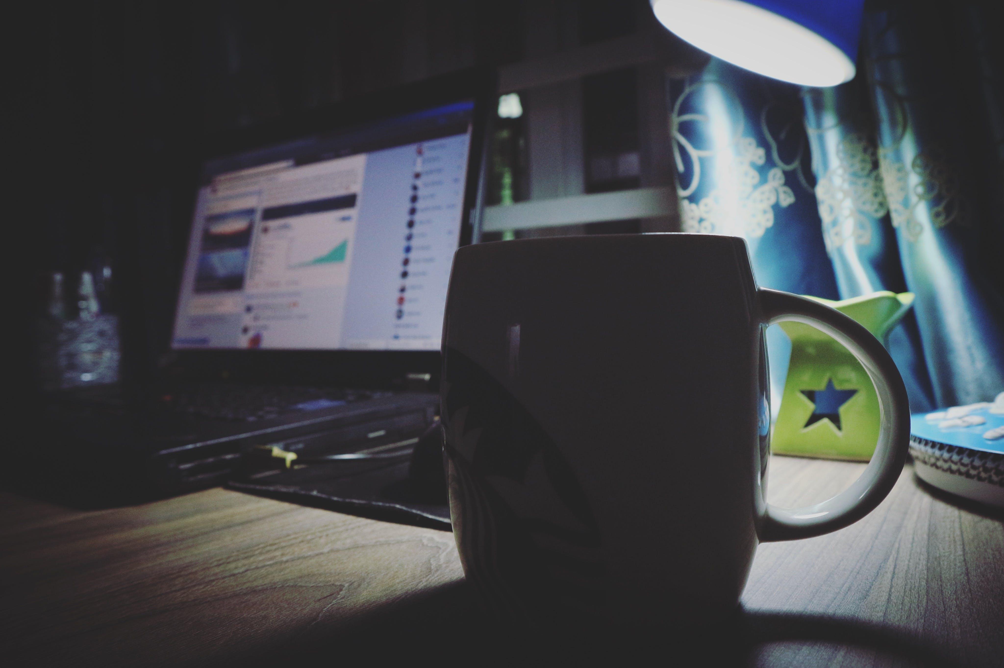 Black Ceramic Mug Near Black Laptop