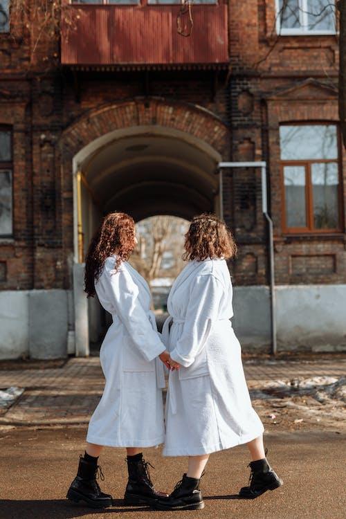 Women in White Robe Walking on Street
