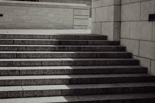Grayscale Photo of a Concrete Staircase