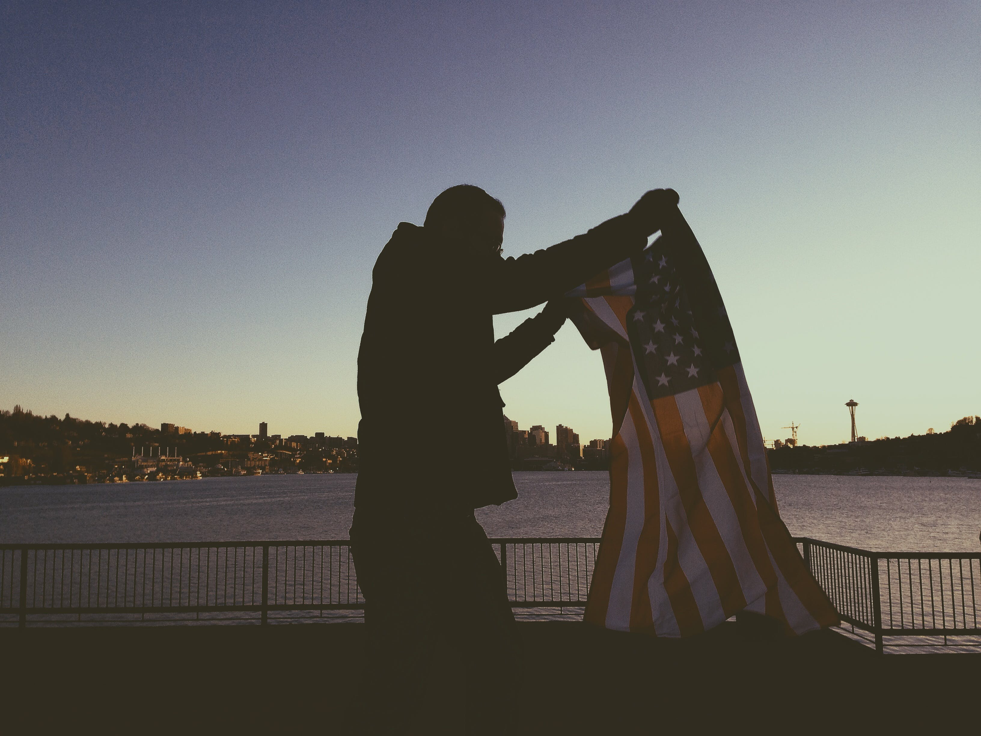 Man Holding Flag of Usa