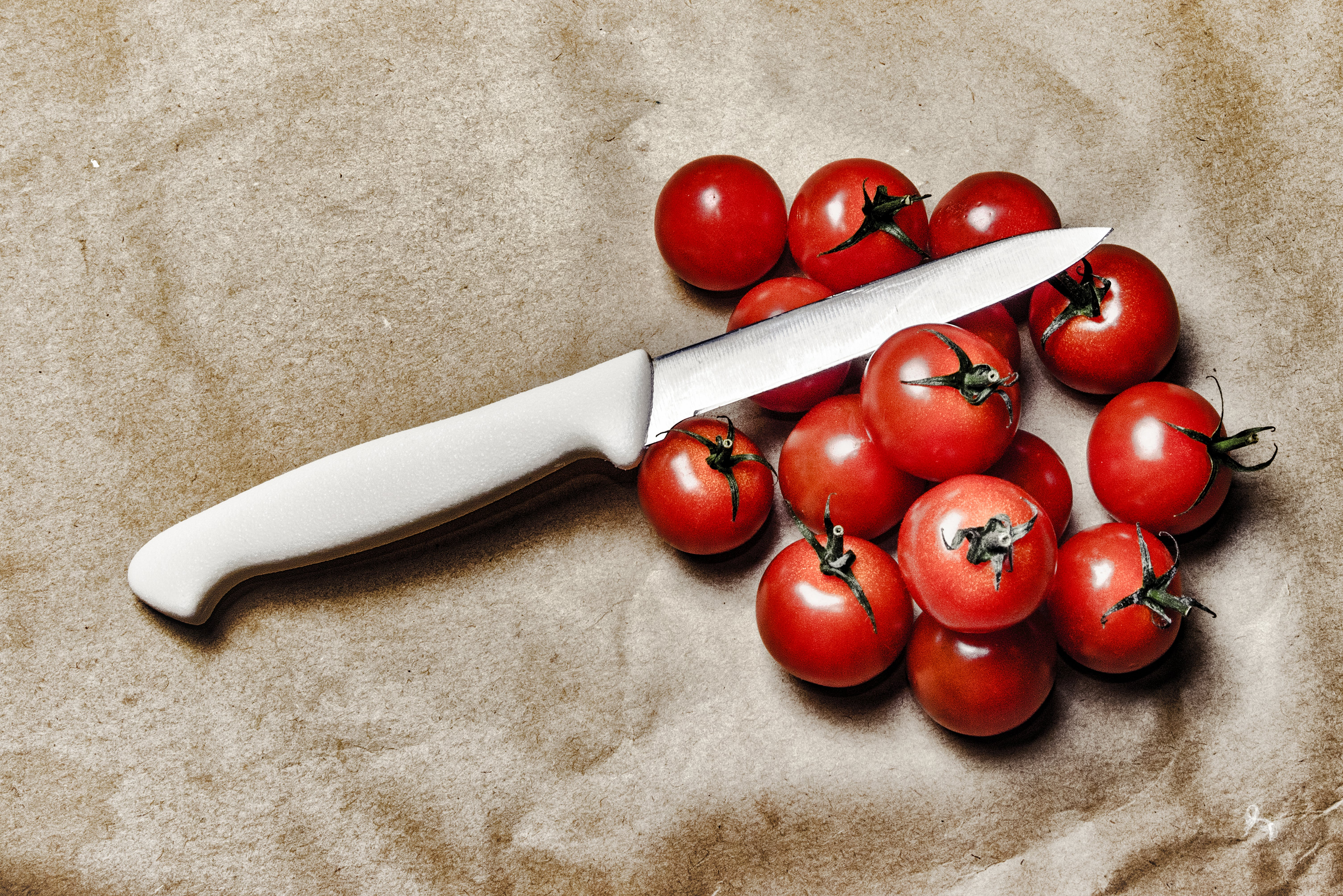 Tomatoes With Knife on Brown Surface