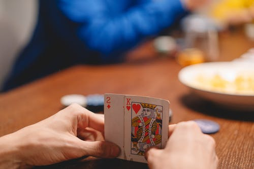 Person Holding Jack of Hearts Playing Card