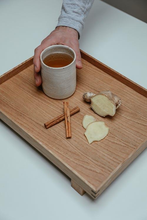 White Ceramic Mug on Brown Wooden Chopping Board